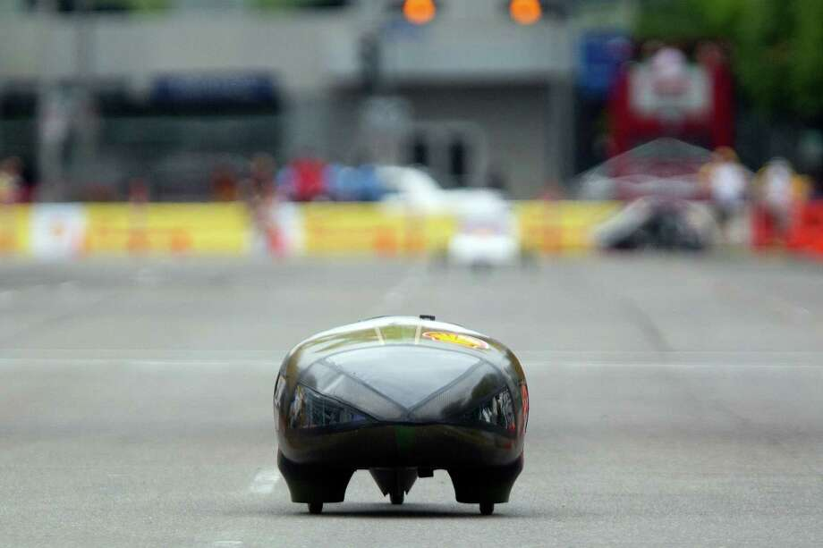 A vehicle makes its way around the Discovery Green track during the Shell Eco-marathon at the George R. Brown Convention Center. Photo: Johnny Hanson, Houston Chronicle / © 2014  Houston Chronicle