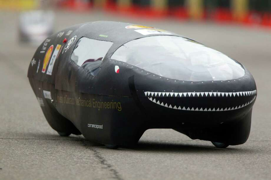 A vehicle from the University of Colorado makes it's way around the Discovery Green track during the Shell Eco-marathon at the George R. Brown Convention Center Saturday, April 26, 2014, in Houston. Photo: Johnny Hanson, Houston Chronicle / © 2014  Houston Chronicle