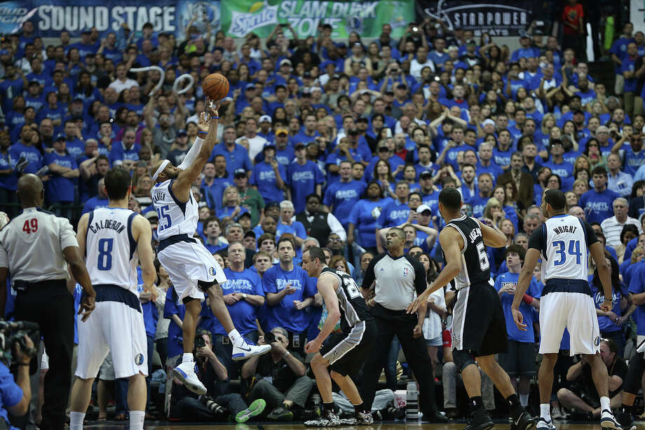 With 1.7 seconds left in the game and down two points, Dallas Mavericks' Vince Carter lobs a three-pointer over San Antonio Spurs' Manu Ginobili to win game three in the first round of the Western Conference Playoffs 109-108 at the American Airlines Center in Dallas, Saturday, April 26, 2014. The Mavericks lead the series 2-1. Photo: Jerry Lara, San Antonio Express-News / ©2014 San Antonio Express-News
