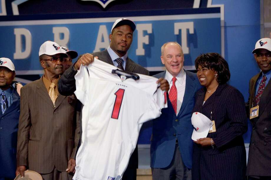 "Bob McNair says the Texans carefully weighed whether the 2006 team would be better with Mario Williams, holding jersey No. 1, or Reggie Bush on it. Then and now, the owner says Williams was ""the right decision."" Photo: BRETT COOMER, STAFF / Houston Chronicle"