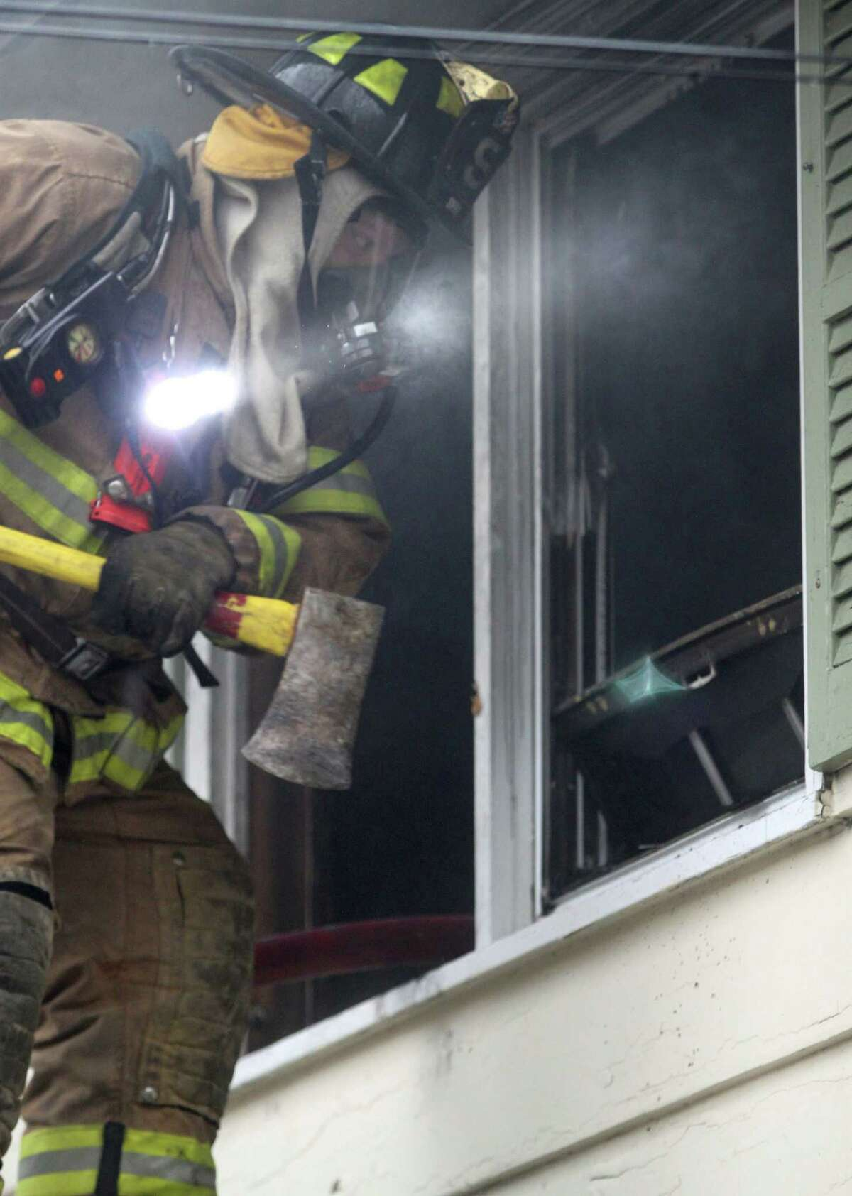 Firefighters work at the scene of a fire on Summit Ridge Road the morning of Saturday, April 26, 2014.