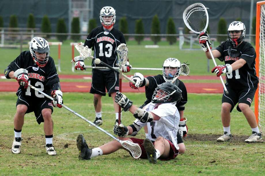Albany Academy and Scotia players battle for the ball in front of the Albany Academy net during their lacrosse game on Saturday April 26, 2014 in Scotia, N.Y. (Michael P. Farrell/Times Union) Photo: Michael P. Farrell / 00026641A