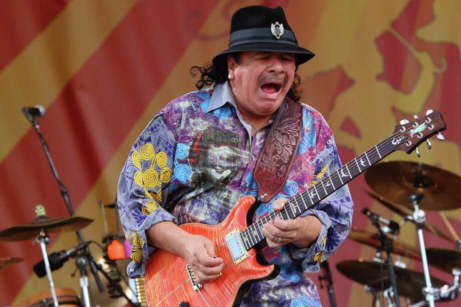 Carlos Santana performs at the 2014 New Orleans Jazz & Heritage Festival at Fair Grounds Race Course, Friday, April 25, 2014, in New Orleans. Photo: John Davisson, Associated Press / Invision