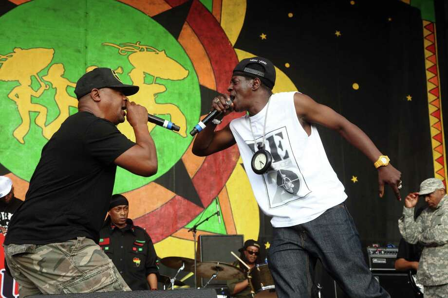 Chuck D and Flavor Flav of Public Enemy perform at the 2014 New Orleans Jazz & Heritage Festival at Fair Grounds Race Course, Friday, April 25, 2014, in New Orleans. Photo: John Davisson, Associated Press / Invision