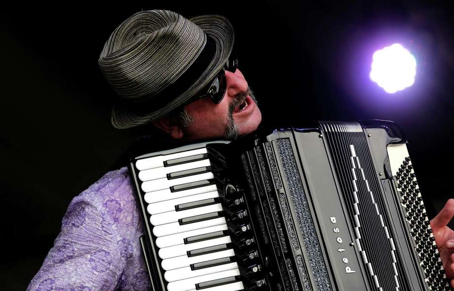 Accordionist Glenn Hartman of the New Orleans Klezmer All Stars performs on the Fais Do Do stage at New Orleans Jazz and Heritage Festival in New Orleans, Friday, April 25, 2014. Photo: Doug Parker, Associated Press / FR 170928AP