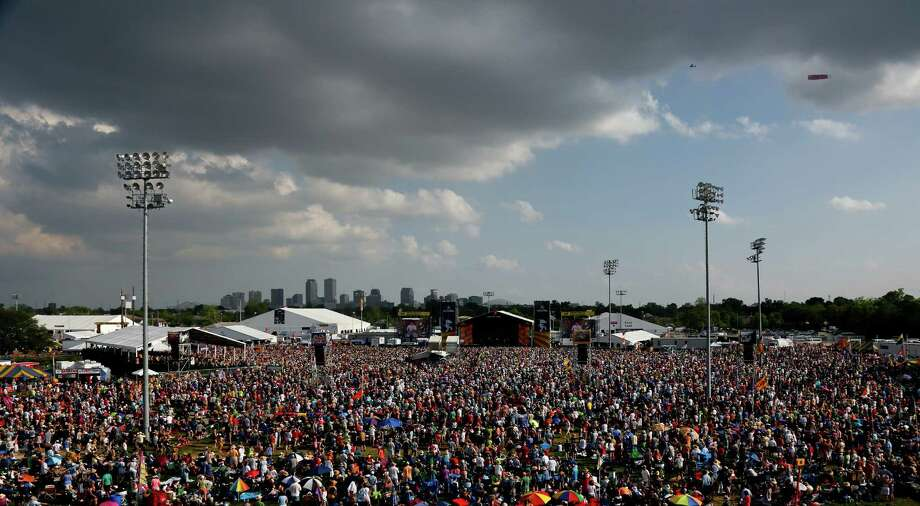 Crowds gather under cloudy skies to hear Carlos Santana perform on the Acura stage during the New Orleans Jazz and Heritage Festival in New Orleans, Friday, April 25, 2014. Photo: Doug Parker, Associated Press / FR 170928AP