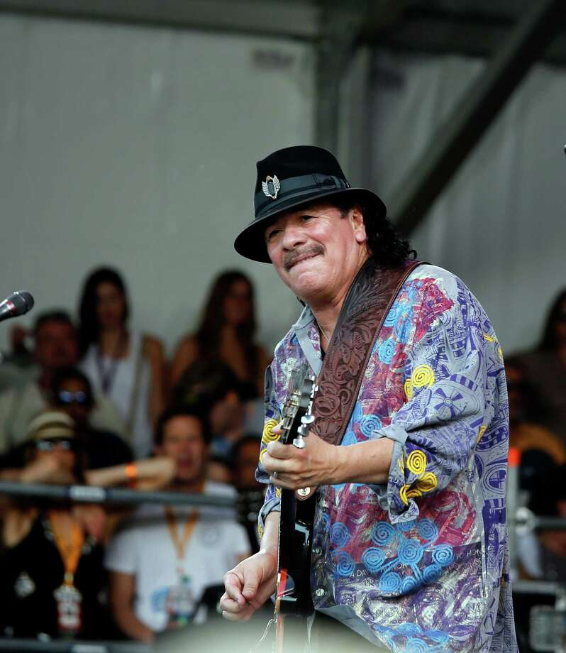 Carlos Santana performs on the Acura stage during the New Orleans Jazz and Heritage Festival in New Orleans, Friday, April 25, 2014. Photo: Doug Parker, Associated Press / FR 170928AP