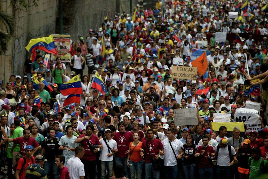 Students shout slogans against Venezuela's President Nicolas Maduro during a protest in Caracas, Venezuela, Saturday, April 26, 2014. Student organizers at the last minute decided against marching downtown to avoid a confrontation with security forces in the government-controlled district. Instead they concentrated in the wealthier, eastern neighborhoods that have been the hotbed of unrest since February. (AP Photo/Fernando Llano) Photo: Fernando Llano, STF / AP