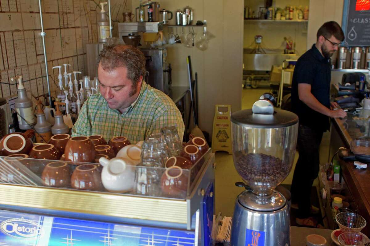 Eric Hammond, left, and Jeremy Perrine, owners of the Pearland Coffee Roasters in the 4100 block of Broadway, came to Pearland after their friends moved there to start a church.