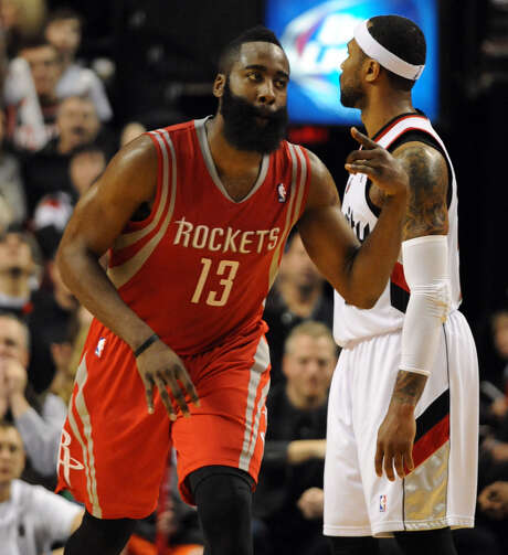 "James Harden and the Rockets pulled out a victory in Portland on Friday to cut Houston's first-round series deficit to 2-1. ""The pressure is on them,"" he said. Photo: Steve Dykes / Getty Images / 2014 Getty Images"