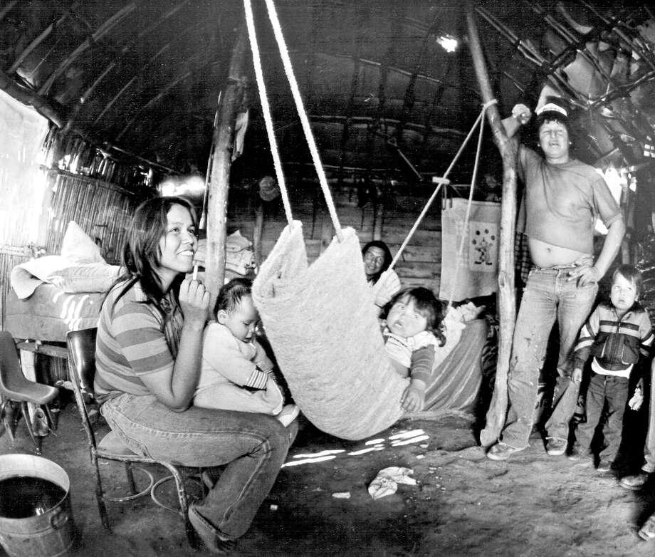 The Suke Jimenez family in their hut on March 2, 1986. Photo: John Davenport / San Antonio Express-News / SAN ANTONIO EXPRESS-NEWS