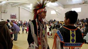 Sage Beene, 14 and his cousin Dante Williams, 10, entertain themselves between dances during the Children's Pow Wow at the Alabama-Coushatta Tribe of Texas Reservation gymnasium on Saturday, January 25, 2014.