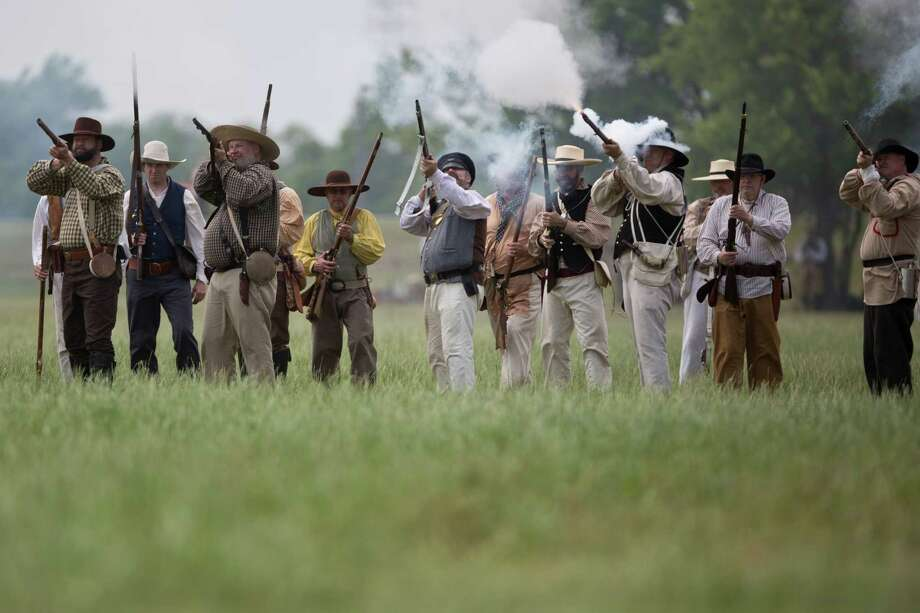Living historians, re-enacting the members of the Texian Army during the Battle of San Jacinto, prepare to attack the Mexican Army during the re-enactment of the battle during the admission-free San Jacinto Festival at the San Jacinto Monument in La Porte, Saturday, April 26, 2014. Photo: Marie D. De Jesus, Houston Chronicle / © 2014 Houston Chronicle