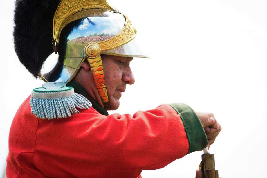 A living historian re-enacting a member of the Mexican Army loads his rifle during a demonstration of the Battle of San Jacinto at the San Jacinto Festival, Saturday, April 26, 2014, in La Porte. The same tactics, and weapons are used to re-enact the battle that took place in April 21, 1836 and represented the victory of the Texas revolution. Photo: Marie D. De Jesus, Houston Chronicle / © 2014 Houston Chronicle