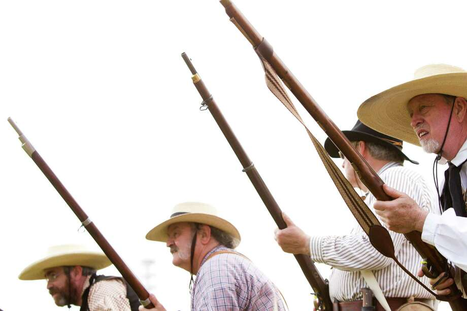 Living historians re-enact the members of the Texian Army during the Battle of San Jacinto, prepare to attack the Mexican Army during the re-enactment of the battle during the admission-free San Jacinto Festival at the San Jacinto Monument in La Porte, Saturday, April 26, 2014. Photo: Marie D. De Jesus, Houston Chronicle / © 2014 Houston Chronicle