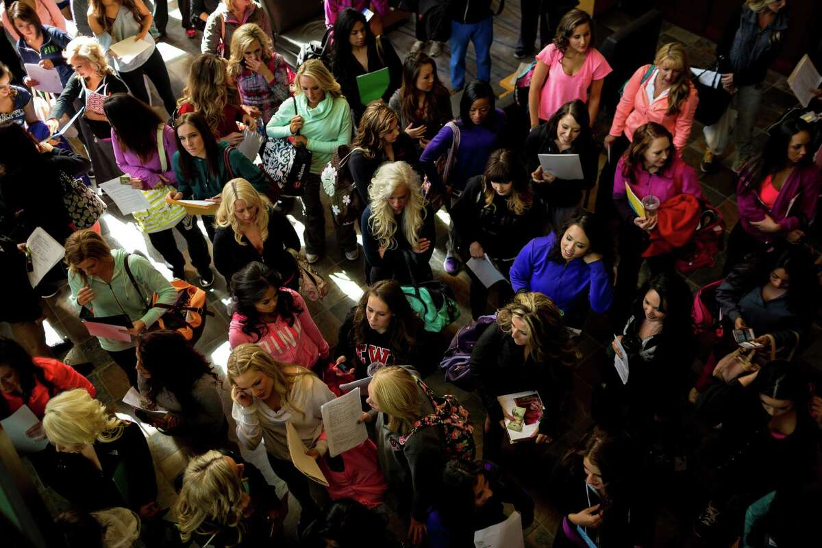 Nearly 300 young women await the beginning of an open audition for the chance at making the Sea Gals.
