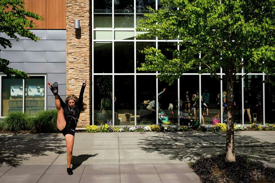 While some chose to stay indoors, other women took to the sunny space outside to warm up. Photo: JORDAN STEAD, SEATTLEPI.COM / SEATTLEPI.COM