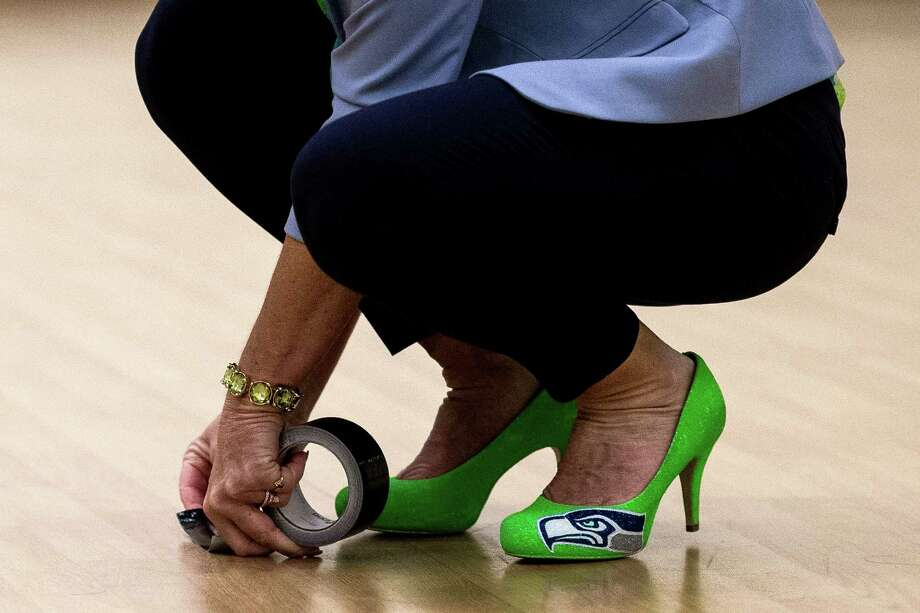 Sporting Seahawks high heels, Sea Gals director and choreographer Sherri Thompson lays down tape for contestants. Photo: JORDAN STEAD, SEATTLEPI.COM / SEATTLEPI.COM