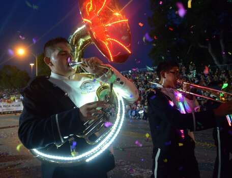 A tuba player from the Instituto Gomez Palacio in Mexico marches during the Fiesta Flambeau parade on Saturday, April 26, 2014. Photo: Billy Calzada, San Antonio Express-News