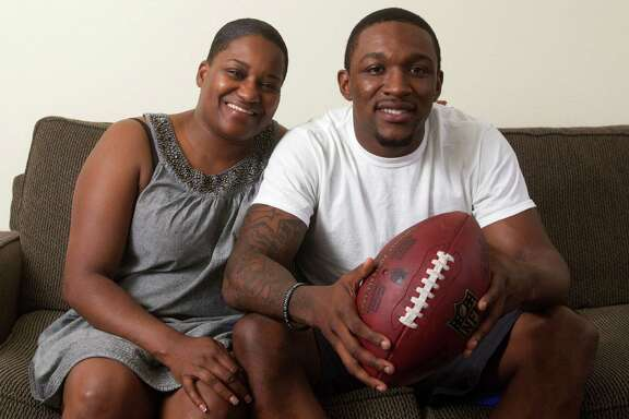 Demetri Goodson's mother, Yolanda Pike, gives her ex-husband Michael Goodson credit for their son's return to football after he shelved his basketball career.