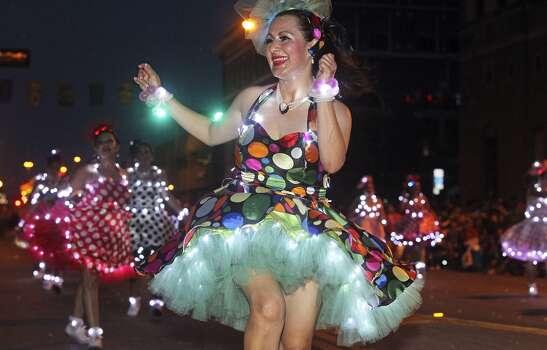 Maria Elena Weisser dances with Las Charangas during the Fiesta Flambeau Night Parade in downtown San Antonio  on April 26, 2014. Photo: Tom Reel, San Antonio Express-News