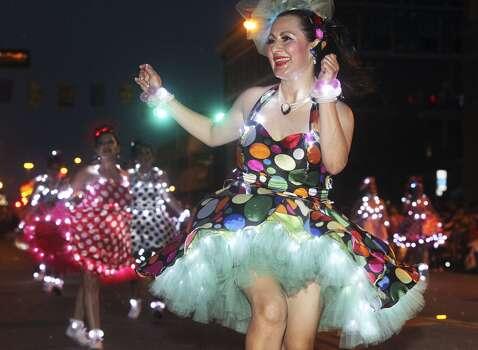 Maria Elena Weisser dances in the lead for Las Chrangas during the Fiesta Flambeau Night Parade in downtown San Antonio  on April 26, 2014. Photo: Tom Reel, San Antonio Express-News