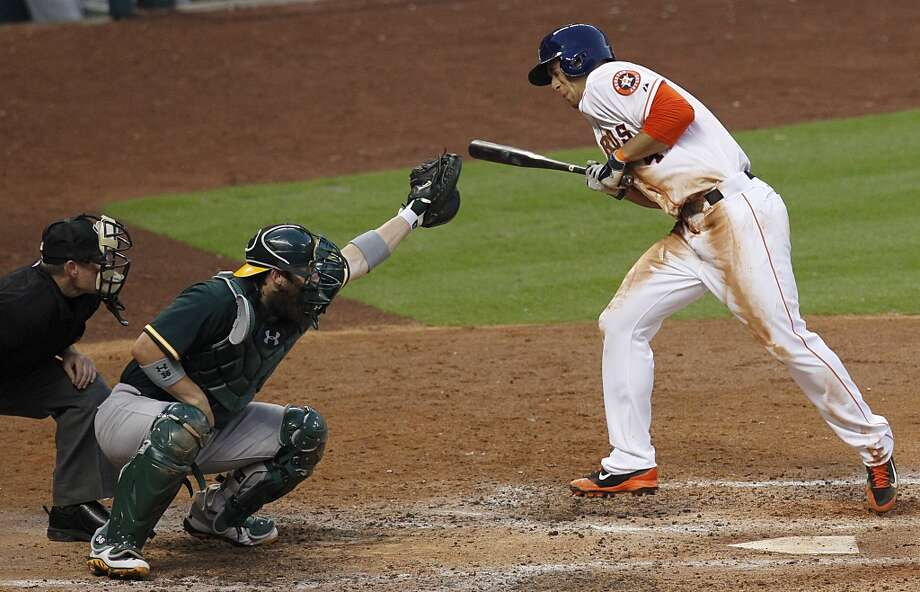 George Springer avoids getting hit by a pitch. Photo: Thomas B. Shea, For The Chronicle