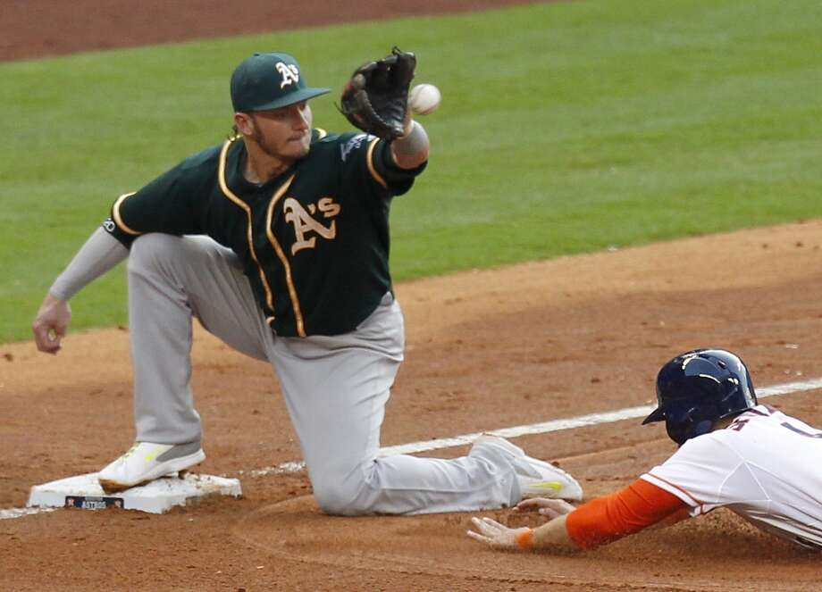Athletics third baseman Josh Donaldson (20) tags out George Springer. Photo: Thomas B. Shea, For The Chronicle