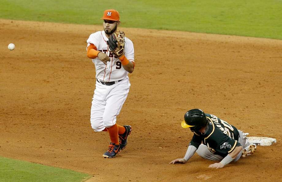 Astros shortstop Marwin Gonzalez (9) turns a double play. Photo: Thomas B. Shea, For The Chronicle