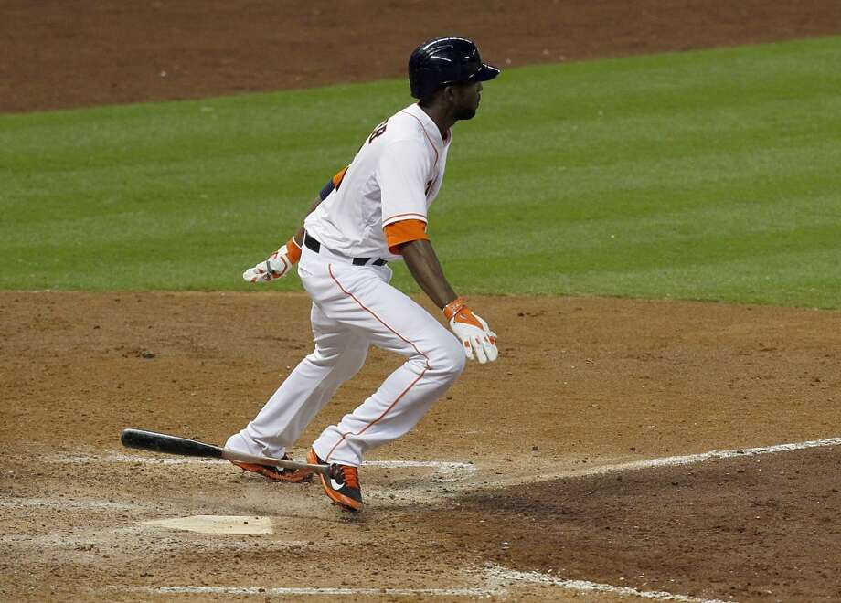 Astros center fielder Dexter Fowler (21) hits a single. Photo: Thomas B. Shea, For The Chronicle
