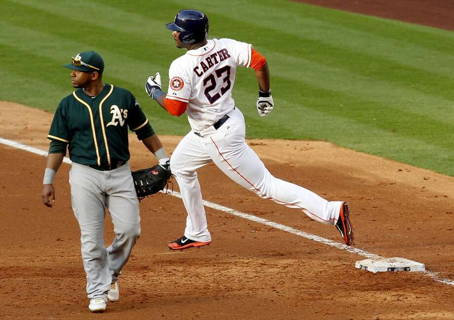 Astros first baseman Chris Carter (23) rounds the bases after hitting a two-run home run. Photo: Thomas B. Shea, For The Chronicle