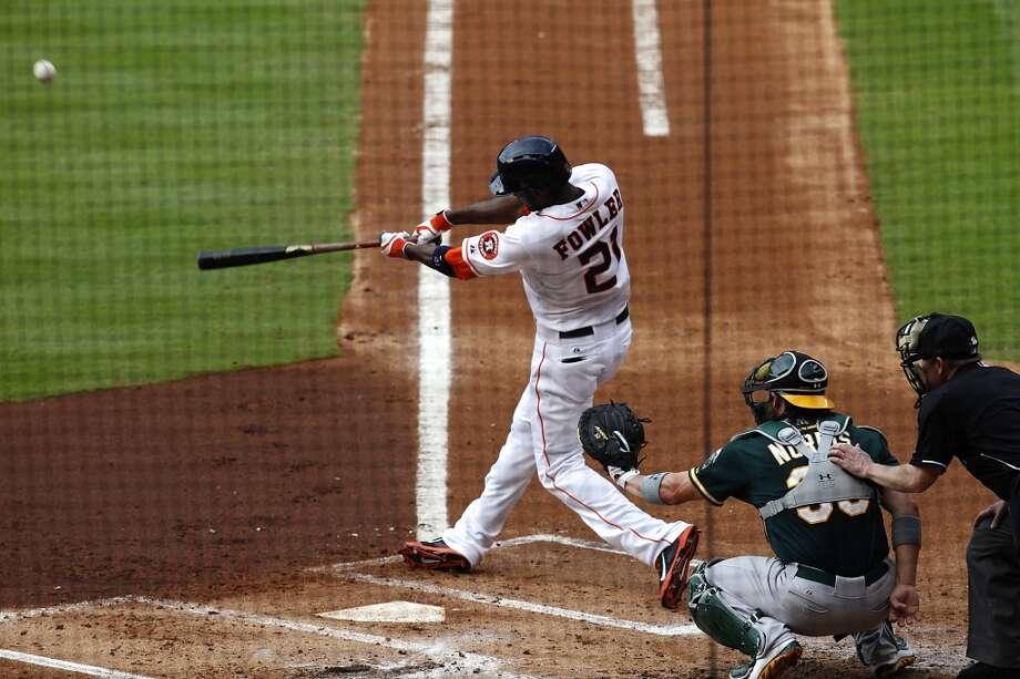 Astros center fielder Dexter Fowler (21) hits a home run. Photo: Thomas B. Shea, For The Chronicle