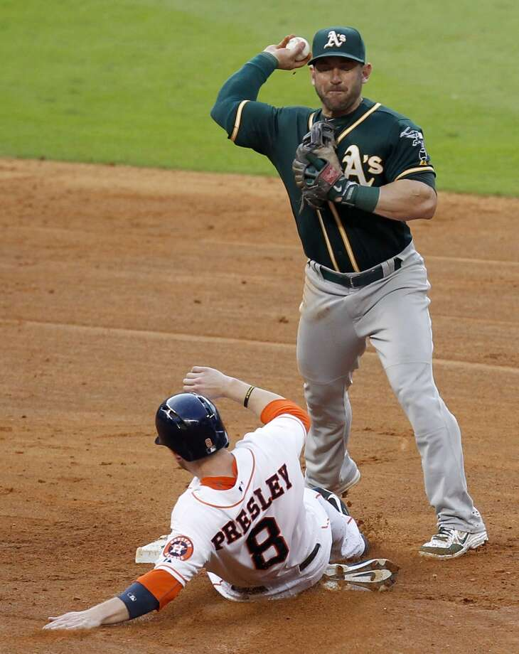 Astros right fielder Alex Presley (8) is forced out at second base. Photo: Thomas B. Shea, For The Chronicle