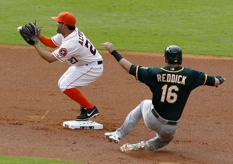 Astros second baseman Jose Altuve (27) forces out Athletics right fielder Josh Reddick. Photo: Thomas B. Shea, For The Chronicle