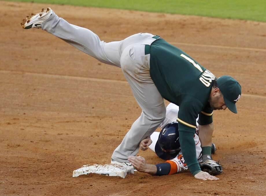 Astros right fielder Alex Presley (8) is forced out at second base by Athletics third baseman Nick Punto. Photo: Thomas B. Shea, For The Chronicle