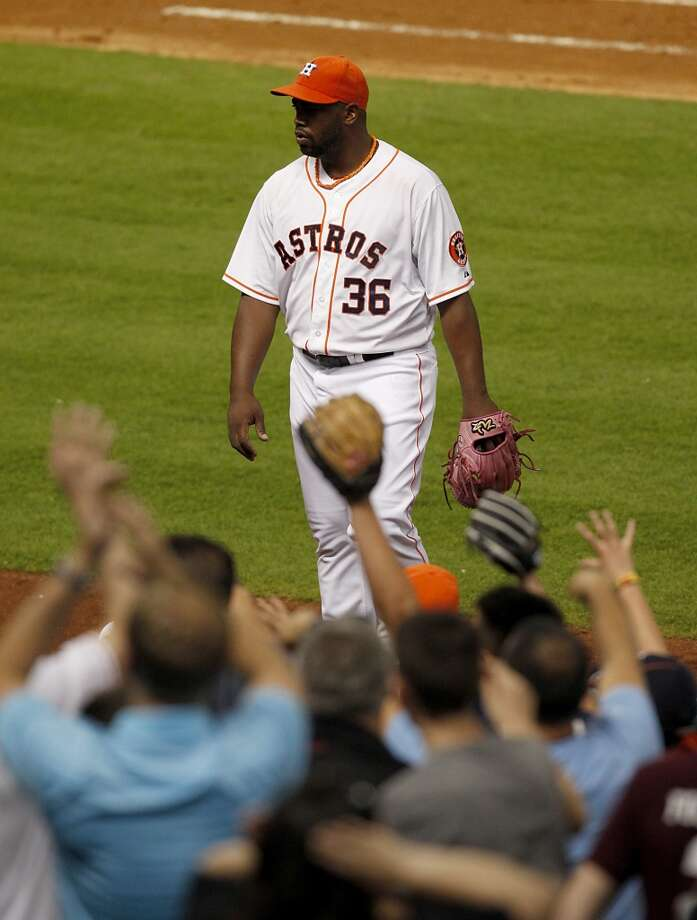 Astros relief pitcher Jerome Williams (36) gets a standing ovation after leaving two Oakland Athletics on base in the seventh inning. Photo: Thomas B. Shea, For The Chronicle