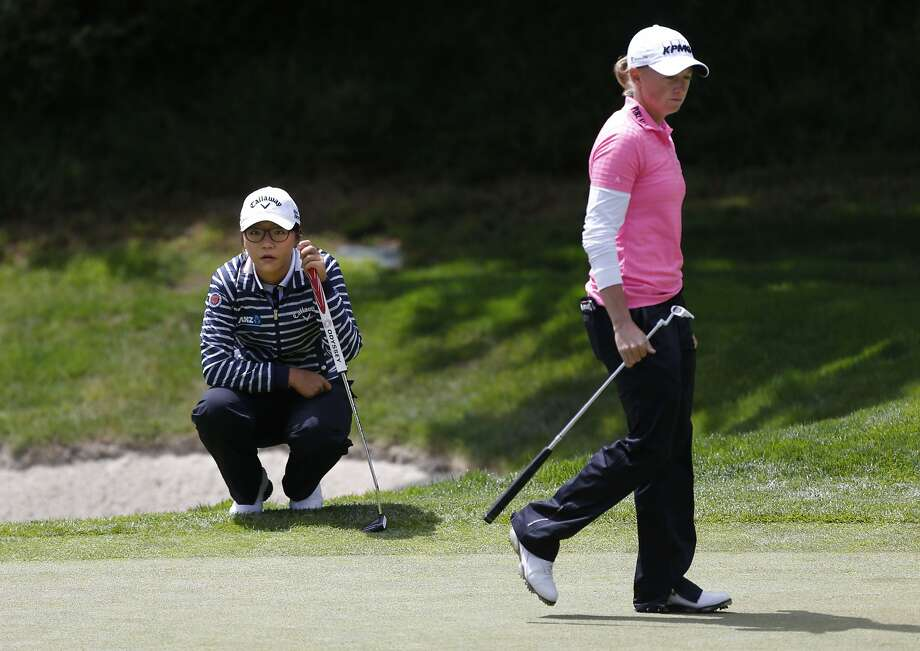 Lydia Ko, (left) and Stacy Lewis size up their putts on the 3rd hole, during the third round of the Swinging Skirts LPGA classic  at Lake Merced Golf Club in Daly City, Calif., on Friday April 25, 2014. Photo: Michael Macor, The Chronicle