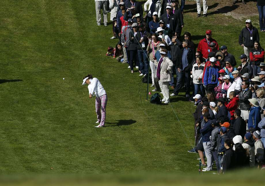 Michelle Wie hits her second shot to the 17th hole at Lake Merced Golf Club. The Stanford alum shot a 1-under 71 to finish the day tied for 13th place. Photo: Michael Macor, The Chronicle