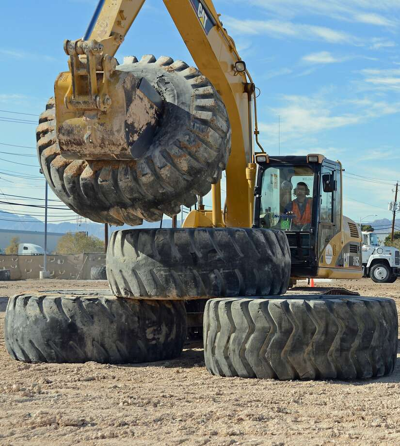 Would-be construction workers can operate heavy equipment like this 18-ton excavator during a 90-minute session at Dig This, a dusty playground for adults that features some really big toys. Photo: Courtesy Of Bill Fink, Special To The Chronicle