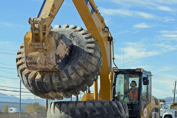 At Dig This in Las Vegas, aspiring construction workers can play games that involve using the 18-ton excavator to stack giant dump truck wheels.