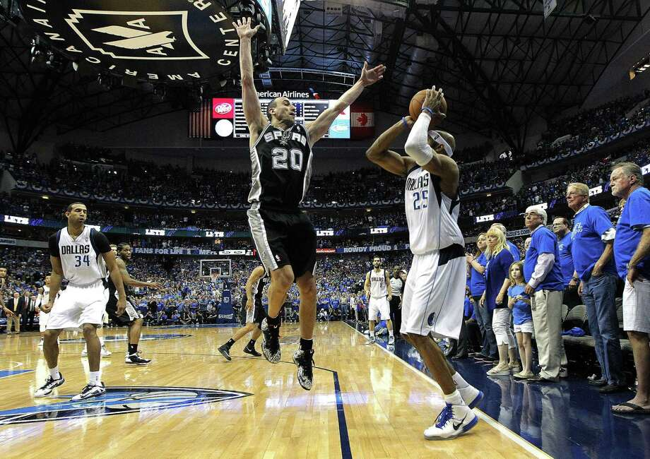 The Mavericks' Vince Carter (25) hits the game-winning 3-pointer against the Spurs' Manu Ginobili, capping Dallas' 109-108 victory in Game 3 on Saturday. Photo: Ron Jenkins, MBR / Fort Worth Star-Telegram