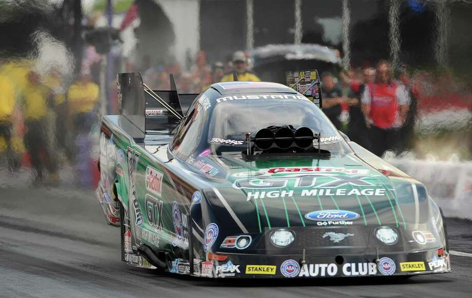 John Force launches during the fourth round of Funny Car qualifying sessions at the O'Reilly Spring Nationals in Baytown. It was Force's 127th consecutive successful qualifier. Photo: Eric Christian Smith, Freelance