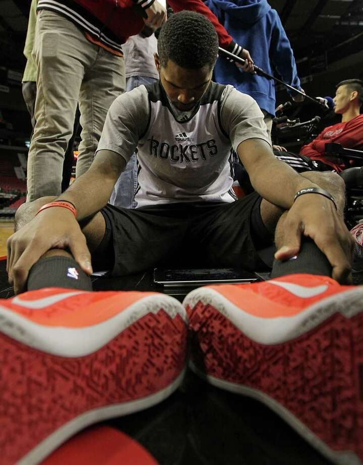 Rockets rookie guard Troy Daniels watches game footage - no doubt of his Game 3-winning shot Friday - during practice Saturday. Photo: James Nielsen, Staff / © 2014  Houston Chronicle