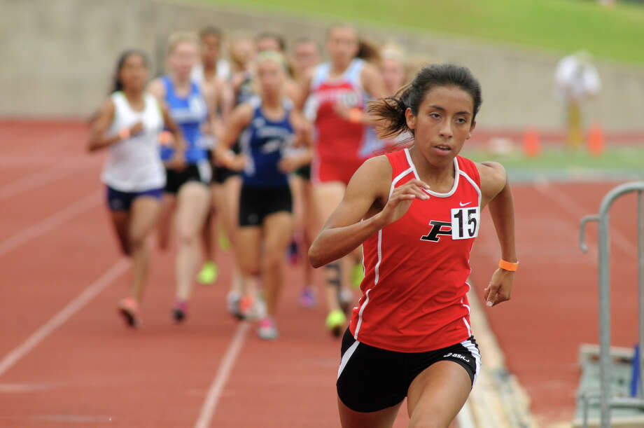 Porter's Evelyn Chavez leaves the field in her wake in breezing to victory in the 1,600-meter race at the Class 4A Region III meet Saturday at Huntsville. Chavez, who won in a time of 5:01.93, qualified for state in two events after winning the 3,200 on Friday. Photo: Jerry Baker, Freelance
