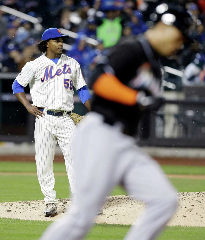 New York Mets' Jenrry Mejia watches as Miami Marlins' Giancarlo Stanton, foreground, runs the bases after hitting a two run home run during the sixth inning of a baseball game, Saturday, April 26, 2014, in New York. (AP Photo/Frank Franklin II) ORG XMIT: NYFF114 Photo: Frank Franklin II / AP