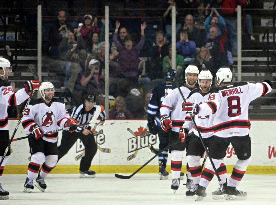 Albany Devils celebrates Stefan Timmins'  goal against St. John's IceCaps late in the second game of a best-of-5 American Hockey League playoff series at the Times Union Center Saturday April 26, 2014, in Albany, NY.  (John Carl D'Annibale / Times Union) Photo: John Carl D'Annibale / 00026569A