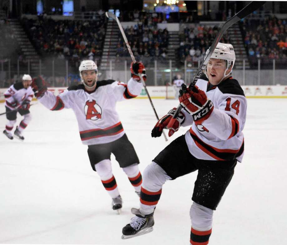 Albany Devils' #14 Reid Boucher, right, celebrates his goal against St. John's IceCaps during the second game of a best-of-5 American Hockey League playoff series at the Times Union Center Saturday April 26, 2014, in Albany, NY.  (John Carl D'Annibale / Times Union) Photo: John Carl D'Annibale / 00026569A