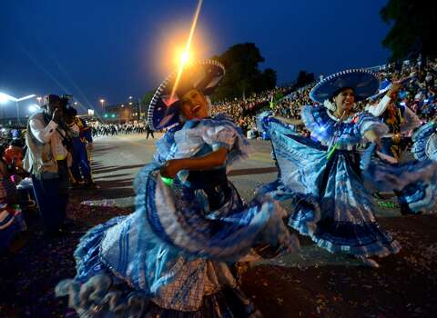 Folklorico dancers perform during the Fiesta Flambeau parade on Saturday, April 26, 2014. Photo: Billy Calzada, San Antonio Express-News