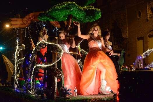 La Vernia beauty queens ride a float during the Fiesta Flambeau parade on Saturday, April 26, 2014. Photo: Billy Calzada, San Antonio Express-News