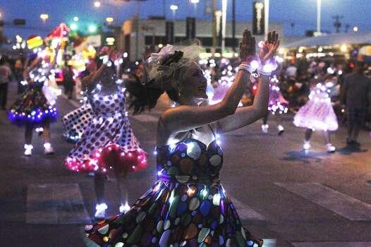 Las Chrangas moves down Broadway during the Fiesta Flambeau Night Parade in downtown San Antonio  on April 26, 2014. Photo: Tom Reel, San Antonio Express-News